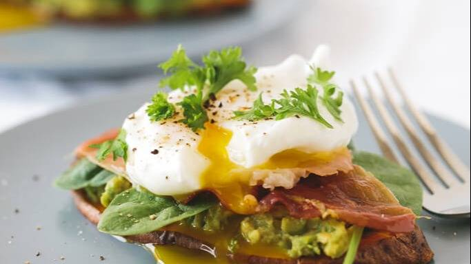 Sweet potato toast with avocado spinach prosciutto and poached egg 51