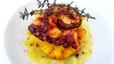 Paprika marinated octopus with saffron and thyme potatoes with leek cream