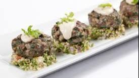 Mini kephta on a couscous salad