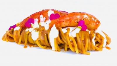 Spaghetti con bisque al limone fonduta di asiago fresco e gamberi marinati in ristretto di agr