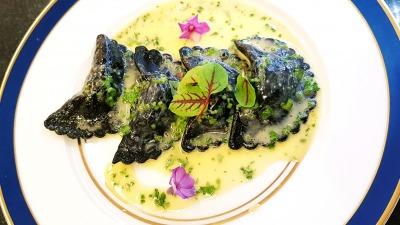 Squid ink ravioli filled with prawn mouse porcini mushrooms