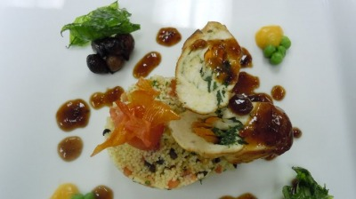 Orn feed chicken breast stuf with feta cheese and vegetables serve with apricot and olives couscous crisp basil and orange sauce