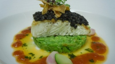 Grilled Halibut with Olive tepenade mushy peas and split tomato sauce