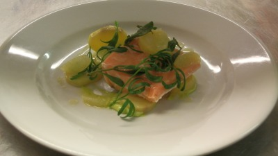Poached salmon with confit potatoes avocado and beach herbs