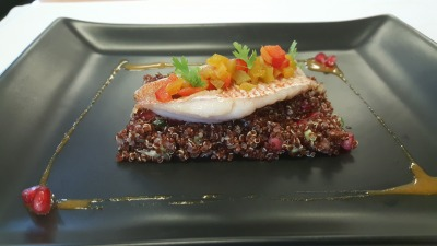 Red mullet filet on quinoa risottoand pomagranate