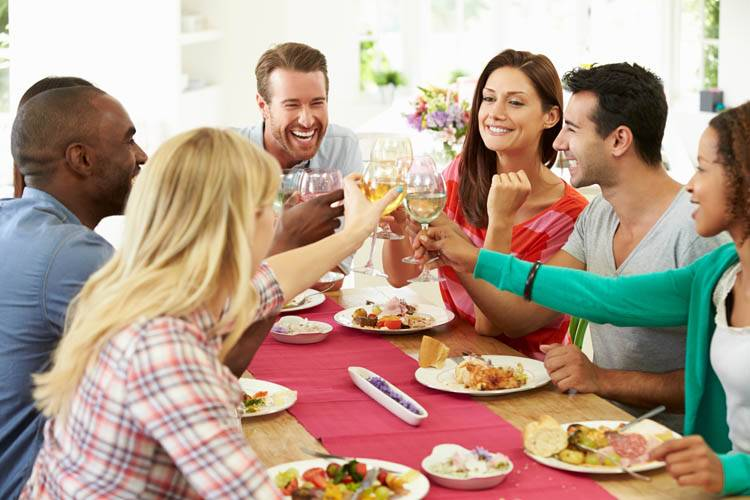 People enjoying a meal prepared by a Private Chef