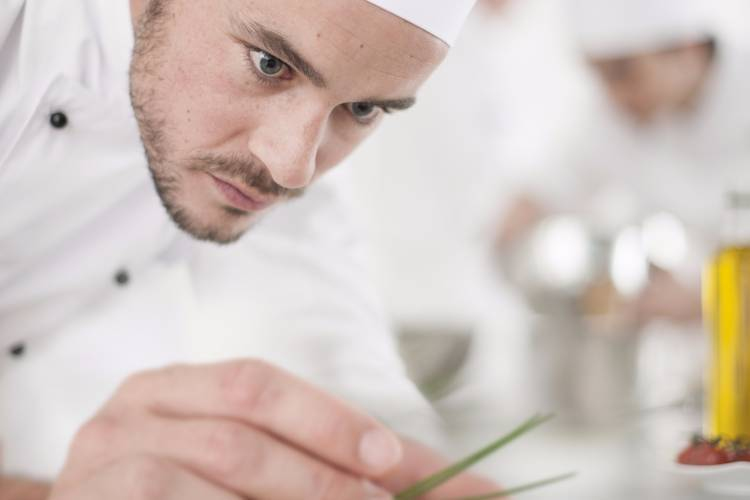 A private chef in Toronto cooking a dish