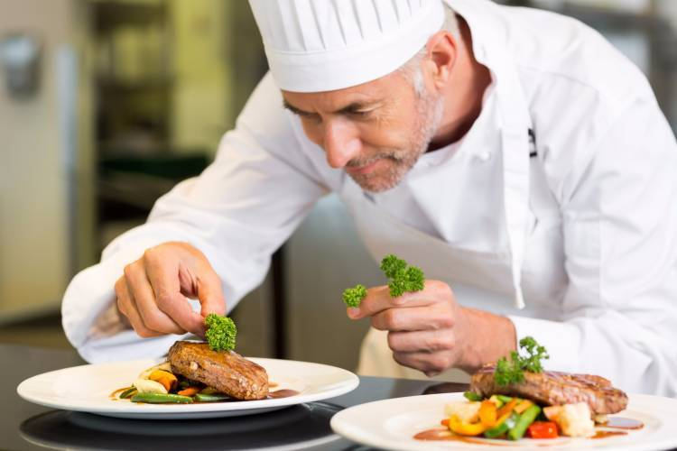 A private chef in Winnipeg cooking a dish