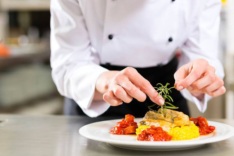 A private chef in Ottawa cooking a dish