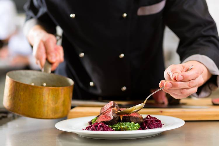A private chef in Perth cooking a dish